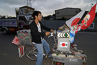 "Kiyotaka Takahashi (19) riding his decochari customized bicycle. He works as a truck driver. ""I spent more money on my decochari than my truck."""