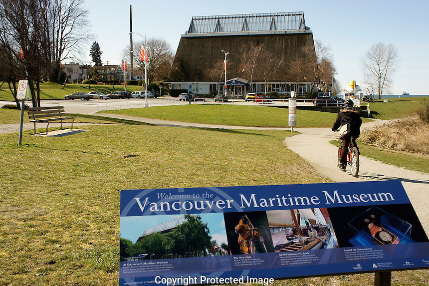 Cyclist and  Vancouver Maritime Museum in Vanier Park, Vancouver, British Columbia, Canada
