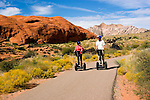 Couple on a Segway at Snow Canyon State Park, Utah, UT, scenic, landscape, Segways, Segway riders, model released, rock formations, landforms, Navajo sandstone, arid, Southwest America, American Southwest, US, United States, Image ut414-18819, Photo copyright: Lee Foster, www.fostertravel.com, lee@fostertravel.com, 510-549-2202
