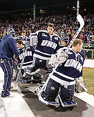 Stevie Moses (UNH - 22), Tyler Scott (UNH - 1), Matt Di Girolamo (UNH - 30), Casey DeSmith (UNH - 29) - The University of Maine Black Bears defeated the University of New Hampshire Wildcats 5-4 in overtime on Saturday, January 7, 2012, at Fenway Park in Boston, Massachusetts.