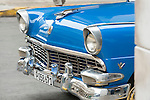 Havana, Cuba; the front end of a classic blue 1956 Ford convertible, parked on the street in Old Havana