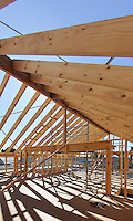 Home construction showing timber roof beams.<br /> <br /> For larger JPEGs and TIFF Contact EFFECTIVE WORKING IMAGE via our contact page at : www.photography4business.com