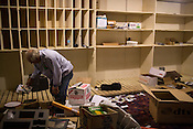 A man picks through the scraps in the film storage room, Galaxy Cinema, Cary, Sat., Jan. 12, 2013.