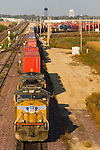 A westbound Union Pacific intermodal container train leaves the terminal in Rochelle, IL.