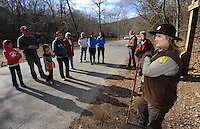 NWA Democrat-Gazette file/ANDY SHUPE<br /> Terry Elder, a park interpreter at Devil's Den State Park, starts a group hike in 2013.