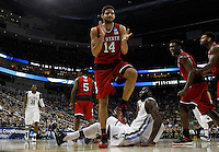 PITTSBURGH, PA - MARCH 21:  Caleb Martin #14 of the North Carolina State Wolfpack celebrates against the Villanova Wildcats in the first half during the third round of the 2015 NCAA Men's Basketball Tournament at Consol Energy Center on March 21, 2015 in Pittsburgh, Pennsylvania.  (Photo by Jared Wickerham/Getty Images)