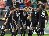 D.C. United midfielder Andy Najar (14) celebrates with teammates his score in the 13th minute of the game. D.C. United defeated Real Salt Lake 4-0 at RFK Stadium, Saturday September 24 , 2011.