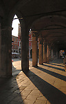 Late afternoon sun shinning through columns of arches, Rialto market, Venice, Italy. May 2007.