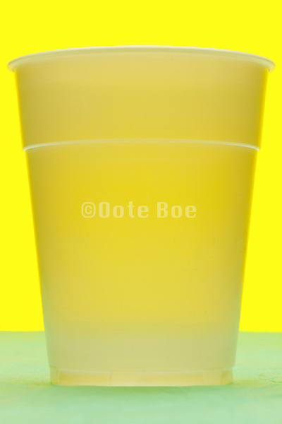 white semi transparent plastic cup still life