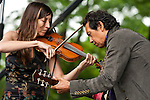 Alejandro Escovedo with Susn Voelz on Violin at the 2009 Clearwater Festival, Croton Point Park, NY 6/20/09.