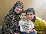 Huda Ismail is a single mother of three in Amman, Jordan. Here she sits with her 3-year old daughter Hiba and her 12-year old son Mohanned. They received a box of household supplies from International Orthodox Christian Charities, a member of the ACT Alliance. IOCC supports Syrian refugee families in Jordan, as well as many poor Jordanian families that have been negatively impacted by rising rents and prices for basic commodities, the result of the influx of Syrians into the city.