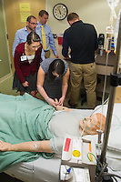 David Harari, left, Lauren Kreiger, center, Jessie Evangelista. Medical, nursing and pharmacy students participate in an interprofessioanl training in patient safety.