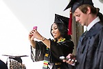 Ashley Osborne, a strategic communication major, takes a selfie before the start of the morning Undergraduate Commencement ceremony on Saturday, May 2, 2015.  Photo by Ohio University  /  Rob Hardin