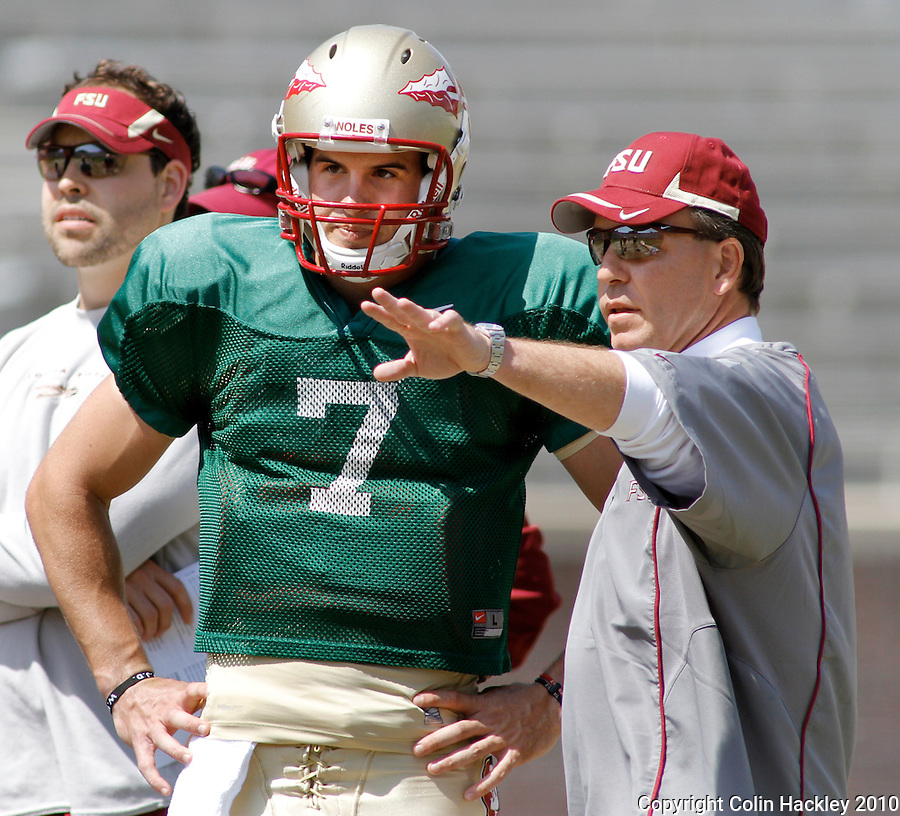 TALLAHASSEE, FL 3/27/10-FSU FB32710 CH-Florida State Head Coach Jimbo Fisher, right, driects Christian Ponder prior to scrimmage Saturday at Doak Campbell Stadium in Tallahassee. .COLIN HACKLEY PHOTO