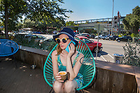 An Austin local enjoys a capucinno coffee at a South Congress Avenue coffee house on a beautiful sunny day - Stock Image