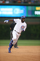 CHICAGO, IL - AUGUST 8:  Dexter Fowler #24 of the Chicago Cubs runs the bases during the game against the San Francisco Giants at Wrigley Field on Saturday, August 8, 2015 in Chicago, Illinois. Photo by Brad Mangin