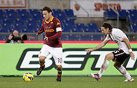 Calcio, Serie A: Roma vs Palermo. Roma, stadio Olimpico, 4 novembre 2012..AS Roma forward Francesco Totti is chased by Palermo midfielder Edgar Osvaldo Barreto, of Paraguay, right, during the Italian Serie A football match between AS Roma and Palermo, at Rome's Olympic stadium, 4 november 2012..UPDATE IMAGES PRESS/Riccardo De Luca