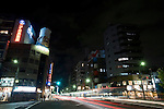 Cars speed up and down the main shopping street of Kappabashi district, in Tokyo, Japan on Nov. 10 2010. Often called Tokyo's Kitchen Town, stores in Kappabashi still mainly caters to professionals in the catering industry, though is becoming increasingly popular with foreigners hunting for unique souvenirs..Photographer: Robert Gilhooly