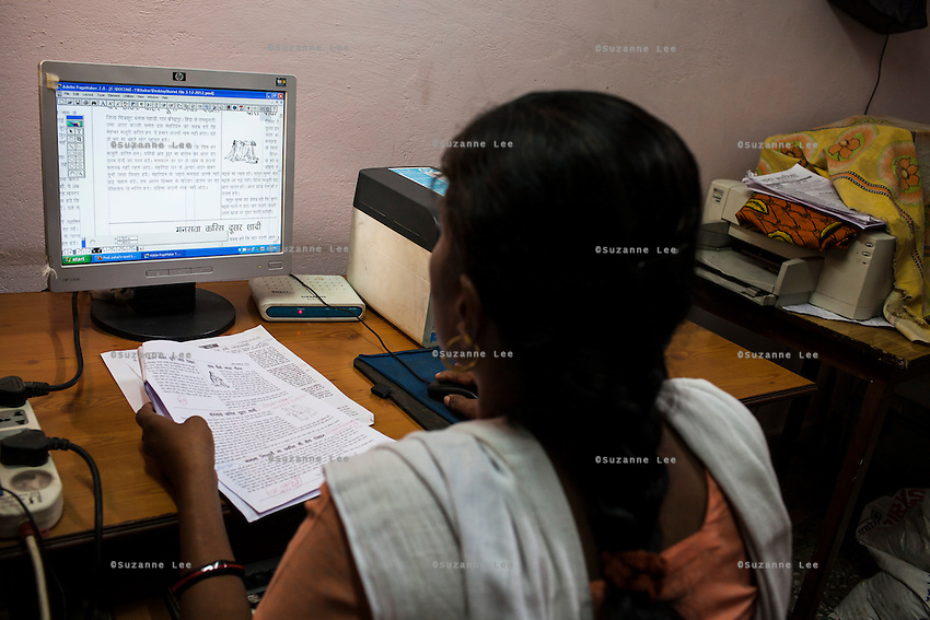 A regional editor works on the layout of a special report issue about violence against women in the regional office in Chitrakoot, Uttar Pradesh, India on 05 December 2012. Photo by Suzanne Lee / Marie Claire France