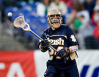 Eric Keppeler (24) of Notre Dame passes the ball during the Face-Off Classic in at M&T Stadium in Baltimore, MD