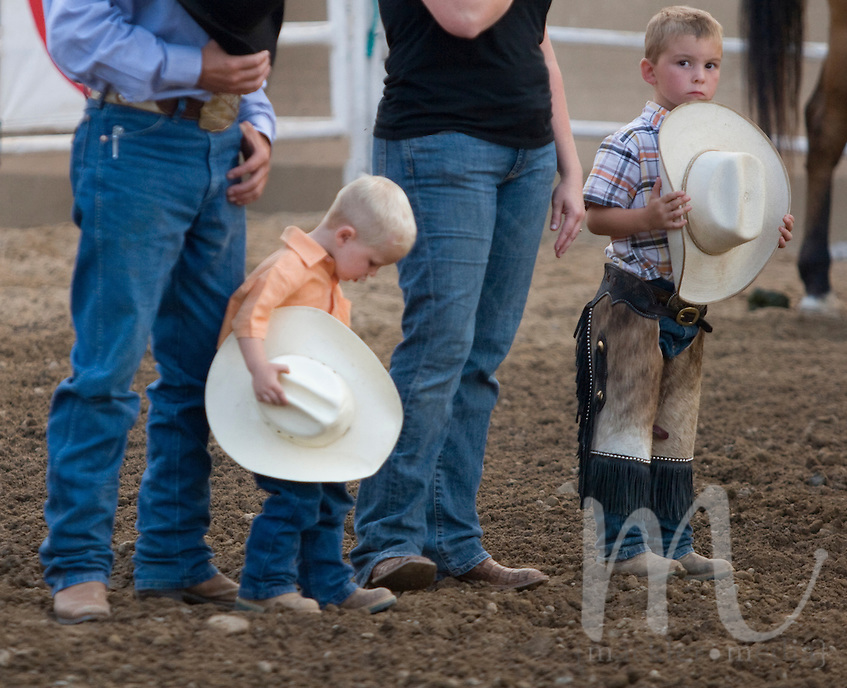 Little Rodeo - Teagan and Blake Mast fidget during the singing of the National Anthem Friday July 25, 2008 on the Elkhart County 4-H Fairgrounds in Goshen, Indiana..