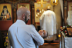 Gazing heavenward in grandfather's arms.<br /> Pascha (Easter) @ St. Nicholas Orthodox church.