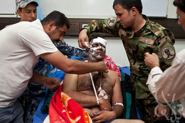 A wounded Iraqi policeman is treated at the Khadamiyah hospital following a car bomb blast in North Baghdad August 25, 2010. A series of coordinated bomb attacks targeting Iraqi security forces killed more than 50 people today across the country, a mere day after U.S. troop levels deployed to Iraq fell below 50,000.   .