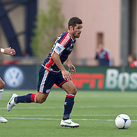 New England Revolution midfielder Benny Feilhaber (22) brings the ball forward. In a Major League Soccer (MLS) match, DC United defeated the New England Revolution, 2-1, at Gillette Stadium on April 14, 2012.