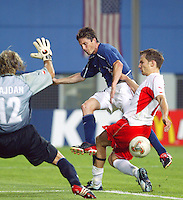 Joe-Max Moore takes a shot against Poland. The USA lost 3-1 against Poland in the FIFA World Cup 2002 in Korea on June 14, 2002.