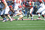 Arkansas quarterback Tyler Wilson (8) is sacked by Ole Miss' C.J. Johnson (10) at Vaught-Hemingway Stadium in Oxford, Miss. on Saturday, October 22, 2011. .