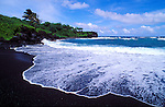 Black sand beach and surf at Waianapanapa State Park, Hana, Maui, Hawaii USA