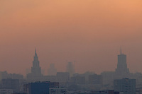 Moscow, Russia, 28/07/2010. .The Moscow skyline at dusk obscured by smog in the record high temperatures of the continuing heatwave. Peat and forest fires in the countryside surrounding Moscow have resulted in the Russian capital being blanketed in heavy smog.