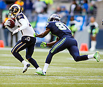 St. Louis Rams defensive back Marcus Roberson (47) is run down by Seattle Seahawks wide receiver Kevin Norwood (81) after intercepting a Russell Wilson pass  during the second quarter  at CenturyLink Field in Seattle, Washington on December 28, 2014. The Seahawks officially wrapped up the No. 1 seed in the NFC playoffs shortly after beating the Rams, 20-6. Despite the Cowboys and Packers also winning to finish 12-4, the Seahawks (12-4) won the multi-team tiebreaker and earned home-field advantage throughout the playoffs for the second consecutive season.  ©2014. Jim Bryant Photo. All Rights Reserved.