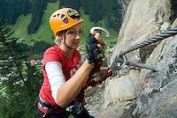 "Mayrhofen, Zillertal, Tyrol, Austria. The Nasenwand klettersteig with safety cables and footholds has a degree of difficulty corresponding to category ""C-E"" in the middle to upper range. In particular, its length and the level of exposure make it a really demanding ""Via Ferrata"". The steep track goes through thin mountain forest and across outcrops of rock; and climbers have an impressive view over the mountaineering village during the entire course of the climb, which compensates for all the effort needed. The Zillertal region offers at least 5 via ferrata climbing routes, better known as Klettersteige. Photo by Frits Meyst/Adventure4ever.com"