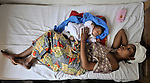 In a maternity clinic of the United Methodist Church in Kananga, a town in the Democratic Republic of the Congo, Sabina Dituku rests with her week-old baby, Mbuji Kayembe.