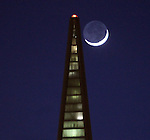 The crescent moon setting behind Transamerican Pyramid as seen from Pier 1, San Francisco, CA.