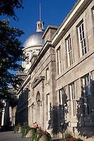 A young couple sitting on the steps of the Bonsecours Market or Marche Bonsecours building on Rue St. Paul in Old Montreal, Quebec, Canada