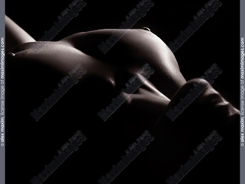 Sensual erotic bodyscape of a nude woman breast and mouth with open lips, artistic body outline, black and white body parts