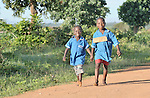 Two boys walk to school along a rural road near Kanyemba, in northern Malawi.