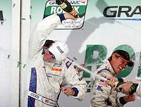 Darren Law, left,  celebrates his win in the Rolex 24 at Daytona , Daytona International Speedway, Daytona Beach, FL, January 2009.  )Photo by Brian Cleary)
