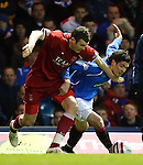 Zander Diamond chops Kyle Lafferty and the Rangers winger goes down