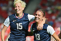 Glasgow, Scotland - July 25, 2012: Megan Rapinoe and Alex Morgan celebrate Morgan's first goal of the day.