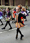 March 16, 2013 - New York, NY, U.S. - Irish dancers get ready to march in the 252nd annual NYC St. Patrick's Day Parade. Thousands of marchers show their Irish pride, as they march up Fifth Avenue, and over a million people, often in green and orange, watch and celebrate. Those marching, many who wore kilts, uniforms, colorful costumes, sashes, included Bag and Pipe Bands; Irish dancers; fire, police, military, religious, educational, and social groups.
