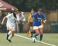 Duke University forward Laura Weinberg (16) dribbles down the wing as Boston College midfielder Coco Woeltz (2) closes.Boston College (white) defeated Duke University (blue/white), 4-1, at Newton Campus Field, on October 6, 2013.