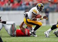 Ryan Shazier brings down Iowa's Damon Bullock   Eamon Queeney/Dispatch
