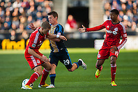 Antoine Hoppenot (29) of the Philadelphia Union collides with Ryan Richter (33) of Toronto FC. Toronto FC and the Philadelphia Union played to a 1-1 tie during a Major League Soccer (MLS) match at PPL Park in Chester, PA, on April13, 2013.