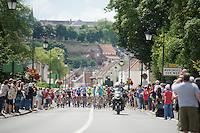 peloton moving through the village of Montreuil Sur Mer with Team Astana leading<br /> <br /> 2014 Tour de France<br /> stage 4: Le Touquet-Paris-Plage/Lille M&eacute;tropole (163km)