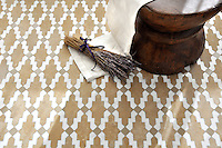 Navarra, a handmade mosaic shown in Fireclay Spanish Moss, honed Lavigne and polished Calacatta Tia, is part of the Miraflores Collection by Paul Schatz for New Ravenna.<br />