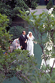 Washington, DC - June 12, 1971 -- United States President Richard M. Nixon, left, escorts his daughter, Tricia, right, to the Rose Garden of the White House in Washington, D.C. on Saturday, June 12, 1971 shortly before she was married to Edward Cox in a White House ceremony.  .Credit: Pool via CNP