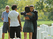 United States President Barack Obama hugs an unidentified woman as he and First Lady Michelle Obama visit Section 60 at Arlington National Cemetery, on Saturday, September 10, 2011, in Arlington, Virginia.  This section contains military personnel who were killed in the Iraq and Afghanistan wars since 9/11. .Credit: Leslie E. Kossoff / Pool via CNP